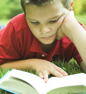 boy-reading-book-outside.jpg